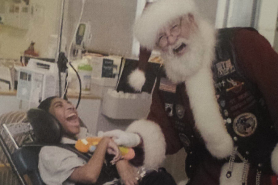 Joe+Sarnoski+brings+a+smile+to+the+faces+of+the+children+he+visits+in+local+hospitals.+He%27s+affectionately+called+%22Santa%22+by+all.