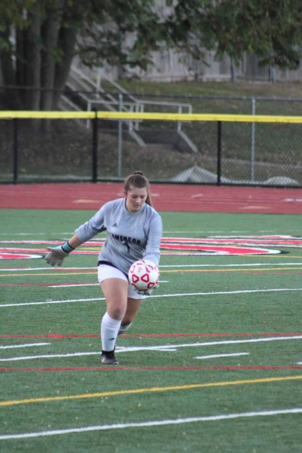 Varsity+Soccer+goalie+Gianna+Mancino%2C+punting+the+ball+downfield.