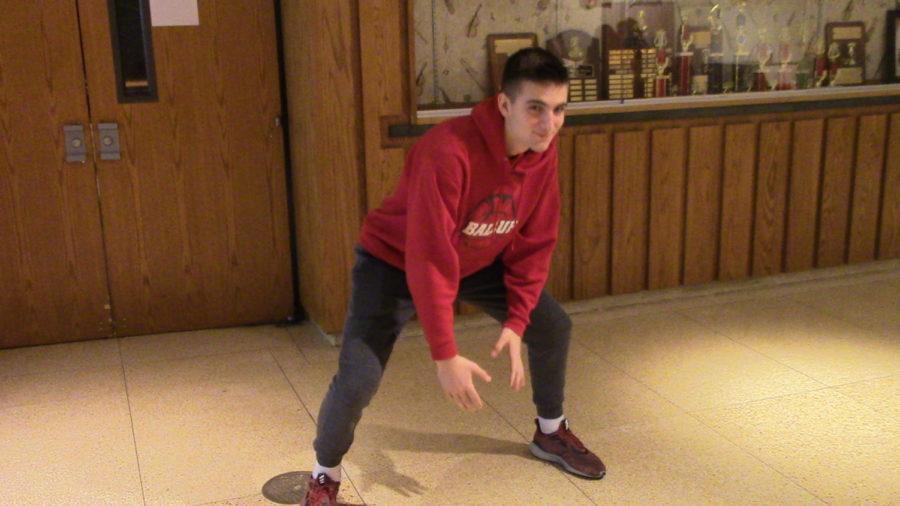 Freshman, Jimmy Csapo showing us his baseball fielding stance while preparing for the season.