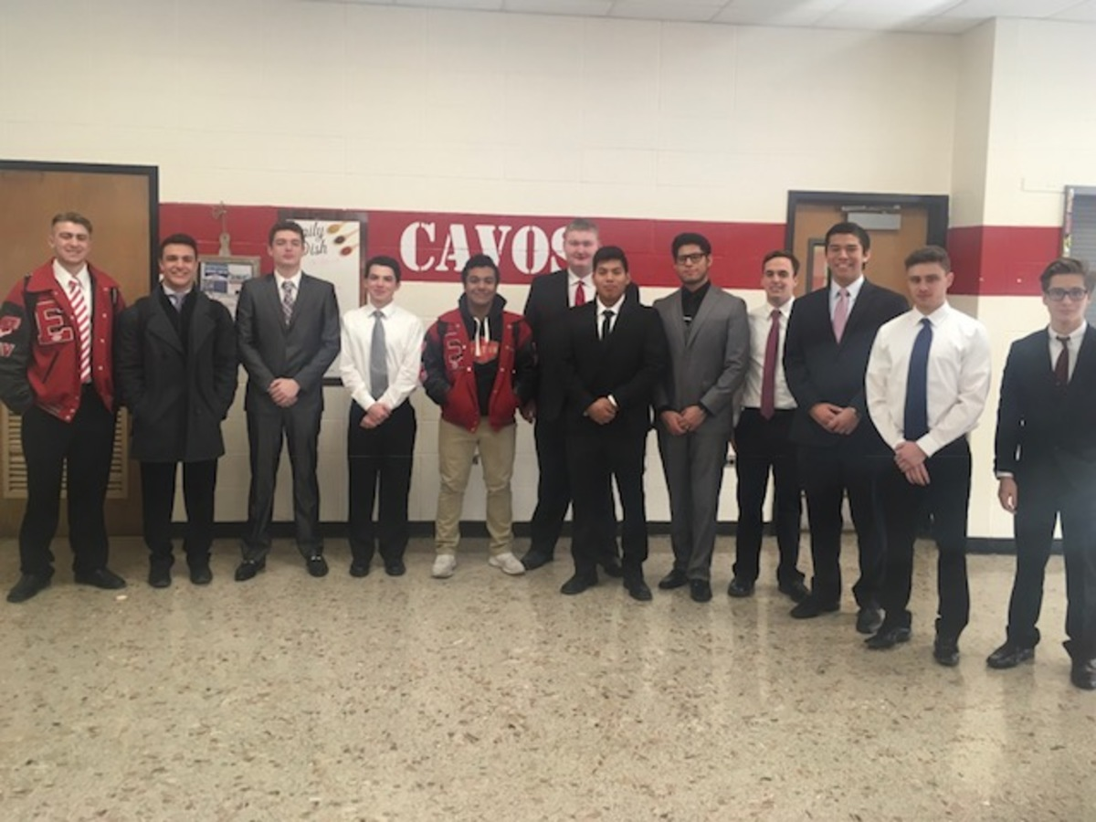 Members of DECA gather in the cafeteria for a group photo on the day of the New Jersey DECA Regional Competition. Pictured from left to right are Nico Savino, Ryan Shaw, Jared Delpome, Ryan Taub, Derek Cartagena, Kevin Carey, Gustavo Ponce-Montes, Rodrigo Flores, John Mulligan, Matt Harada, Jack Terjanian, and Emmett Wieting.