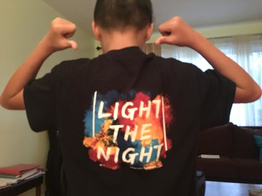 Alex+Cafe%2C+a+seventh+grader+in+the+marching+band%2C+shows+off+his+%22Light+the+Night%22+t-shirt.