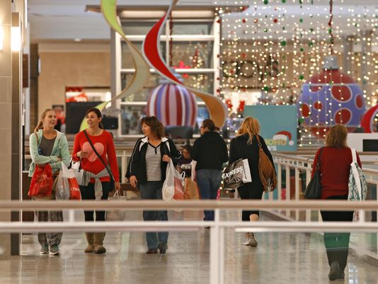 Black Friday shoppers walk around the mall, hoping to find gifts for the holidays.