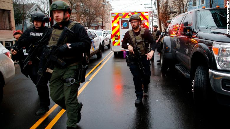 Police+officers+arrive+at+the+scene+following+reports+of+gunfire%2C+Tuesday%2C+Dec.+10%2C+2019%2C+in+Jersey+City%2C+N.J.++AP+Photo%2FEduardo+Munoz+Alvarez%29