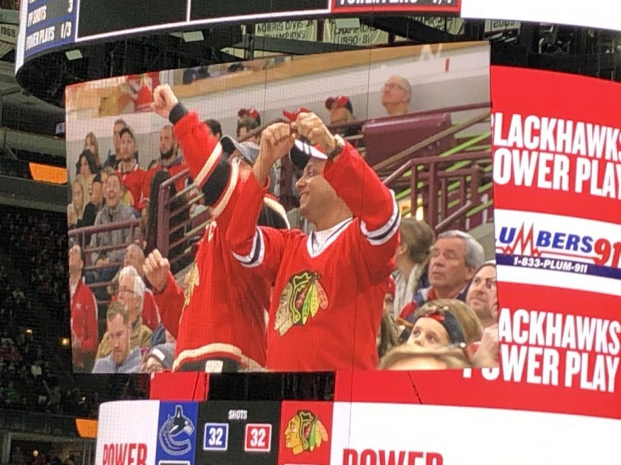 Chicago Blackhawks fans exclaim as they score a goal against the Vancouver Canucks during the game on November 7, 2019.