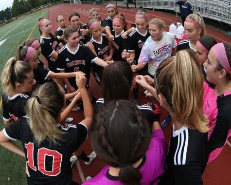 The Girls Soccer Team huddles before the start of their game.